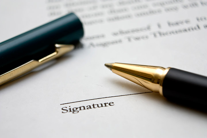 Preparing to sign a legal document.