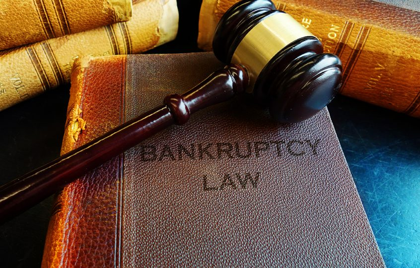 Gavel and book with bankruptcy law written on it