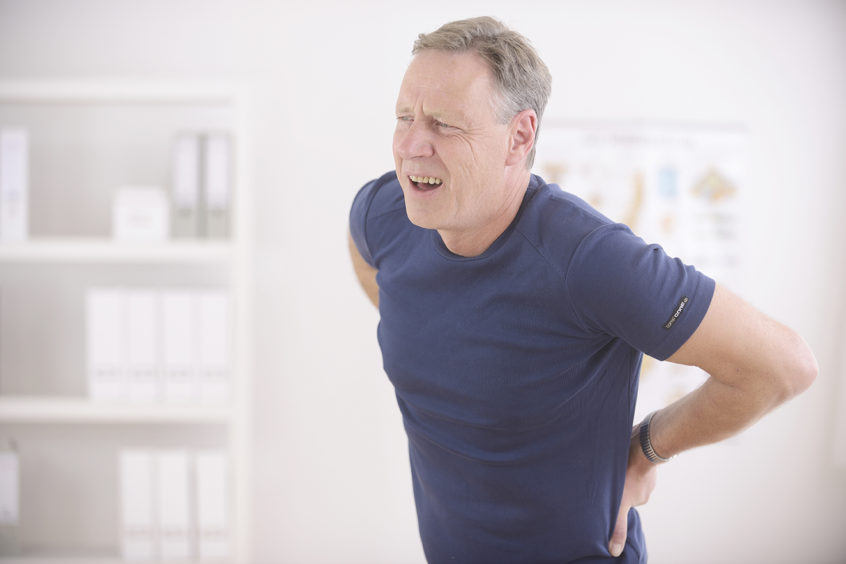 Man who needs a disability attorney because of back pain